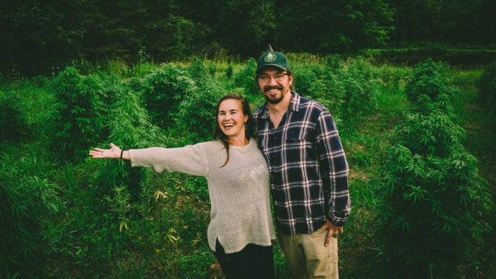 Erin and Colin showing off their hemp field