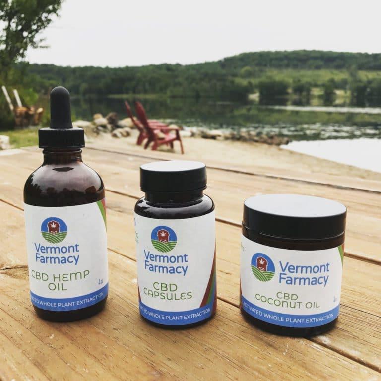 Vermont Farmacy products displayed on a dock: CBD hemp oil, CBD Capsules, CBD Coconut oil