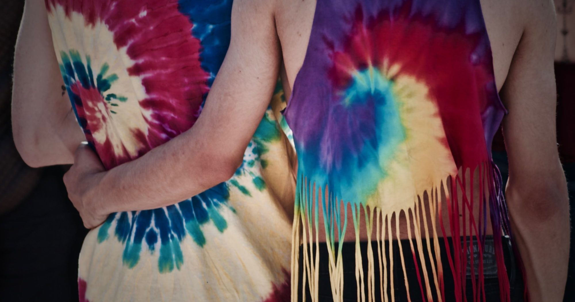 Couple wearing tie dyed shirts